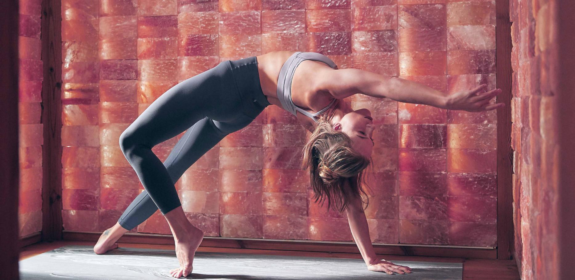 Woman doing yoga in Circle Wellness Studio' WelPod