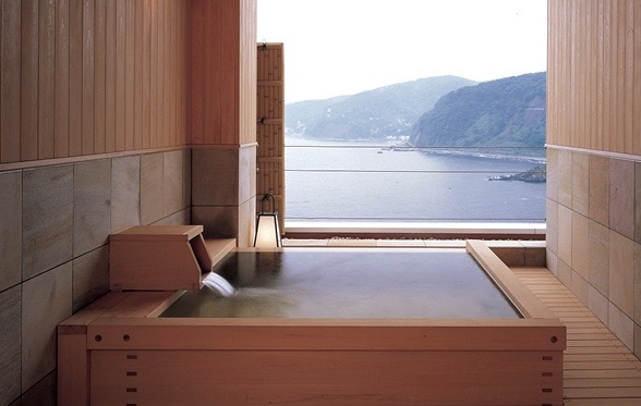 Japanese hinoki tub over mountains and ocean