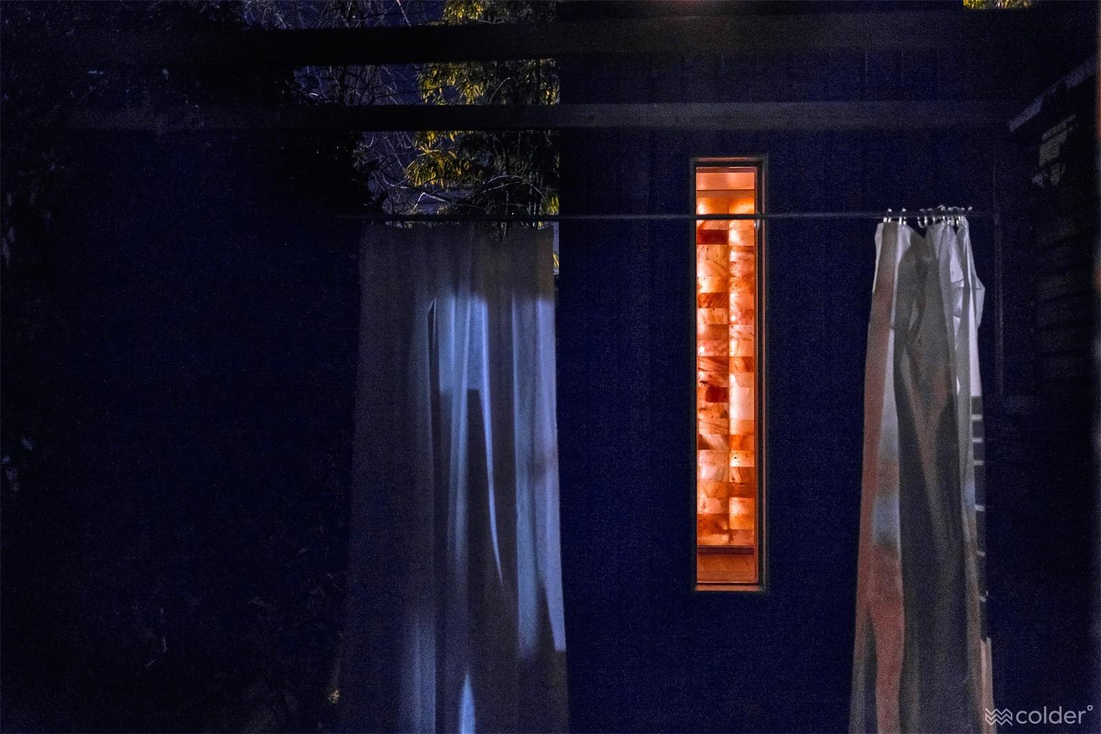 Circle Wellness Studios' WelPod at night with Himilayan Salt walls seen through window