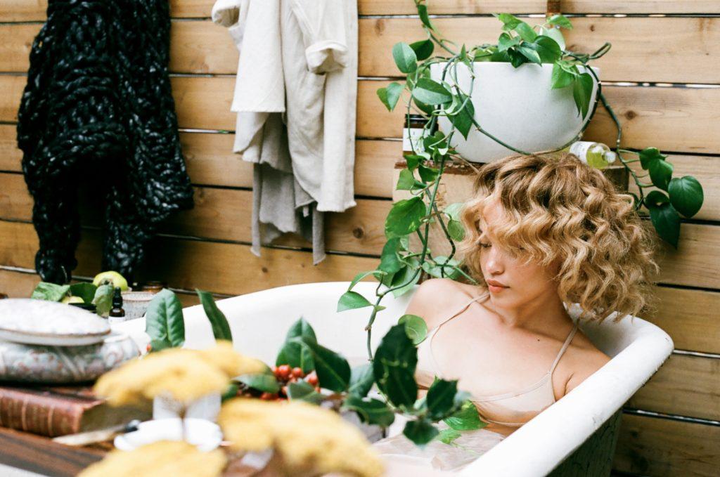 Woman in bathtub outdoor oasis